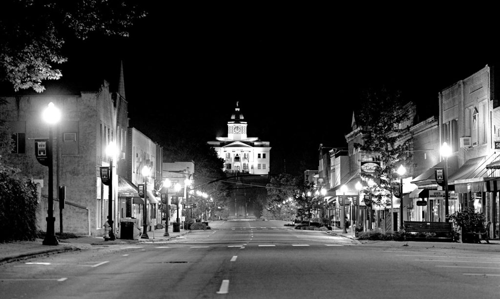 Night time photo of Main Street Sylva NC looking towards courthouse.