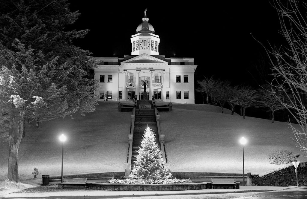 Image of snowy night of the courthhouse at the end of Main Street, Sylva NC.